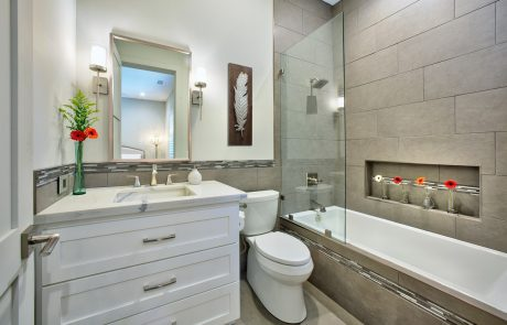 white & gray bathroom with tub