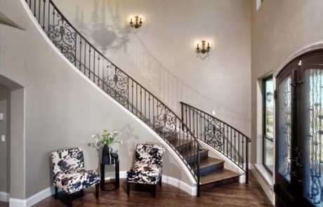 home entry with stairs railing and chandelier