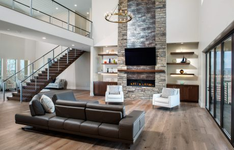 family room fire place and floating stairs